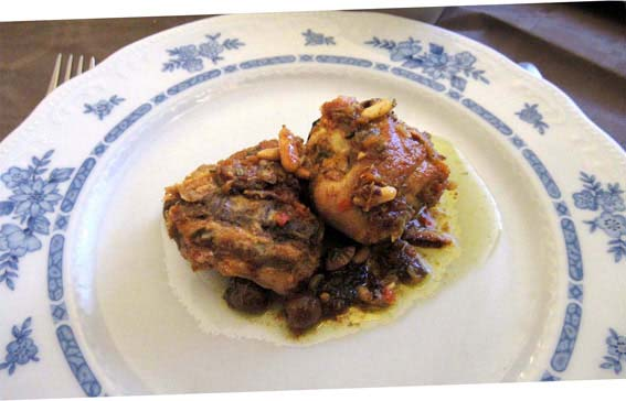 Ligurian rabbit cooked with thyme, bay leaf and rosemary.